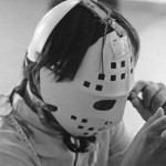 Boy wearing protective headgear and mask